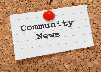 Cordboard with pinned note that says Community News
