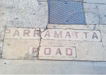 Parramatta Road footpath sign