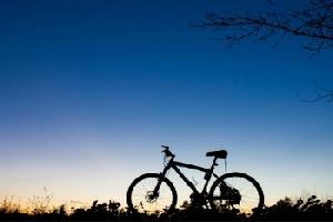image of a bicycle silhouetted against a sunset